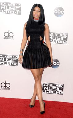 Nicki Minaj from 2014 AMAs Red Carpet Arrivals The rapper maintained her toned down style streak in this LBD by Alexander Wang, which she pairs with Manolo Blahnik pumps.