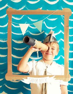 A sailor birthday party. A good inspiration to make a photo booth for any theme with the suspended frame. Cute!!