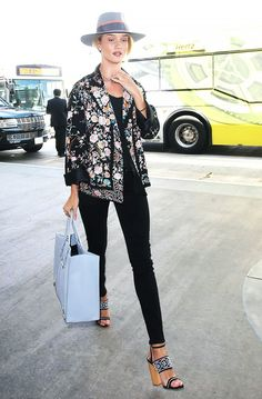 On Huntington-Whiteley: Paige Denim Transcend - Hoxton High Rise Ultra Skinny Stretch Jeans ($179); Balenciaga Papier A4 Side Zip Leather Tote Bag ($1835).