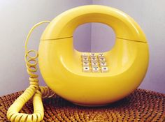 Yellow Donut Phone, Handbag Phone, Midcentury A working land-line push-botton donut desk phone from the 70s era. Everything about this works