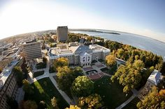 Here's a bird's-eye view of Bascom Hall, its environs, and Lake Mendota. In the distance is a thin peninsula known as Picnic Point, a longtime rendezvous for lovers.