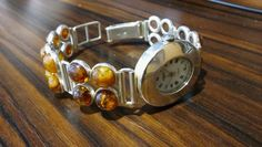 Catawiki online auction house: Bracelet with watch made of sterling silver and amber.
