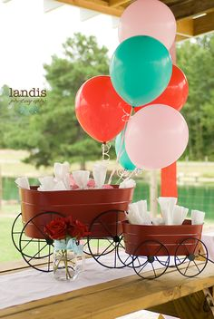 buckets with wheels and ballons