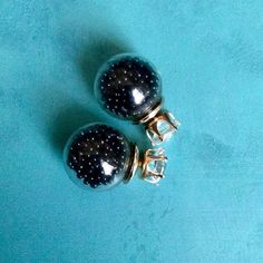 Brand New Double Sided Earrings Ball is filled with black beads. Super cool!! O.S.S Jewelry Earrings