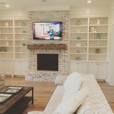 Built ins with a fireplace and the tv. love the fireplace & mantel . IG our_coastal_farmhouse . Fireplace Remodel, Home Living Room, Farm House Living Room, Fireplace Built Ins, Home, White Wash Brick, Living Room With Fireplace, Farmhouse Fireplace, Coastal Living Rooms