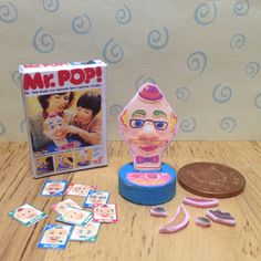 A personal favourite from my Etsy shop https://www.etsy.com/uk/listing/502832870/dolls-house-miniature-replica-mr-pop