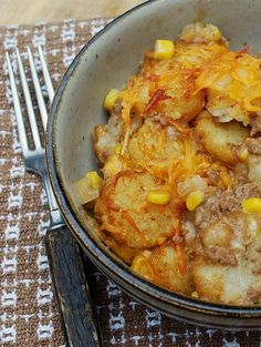 Cowboy Casserole  adapted from a recipe at Taste of Home  1 1/2 pounds ground beef (I used 80/20)  1 medium onion, chopped  3 cloves garlic, chopped  1 can (15.25oz) whole kernel corn, drained  1 can condensed cream of mushroom soup  2 cups cheddar cheese, shredded  1/2 cup milk  4 tablespoons sour cream  1 bag (30 oz) frozen tater tots (I used Ore-Ida Crispy Crowns)