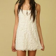 Free People Dress Ruffled Free People dress. In between white and cream color. Has a bit of sparkles to it. Dress it up or down. In perfect condition, worn once. Submit offers via button ?? Free People Dresses