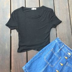 Urban Outfitters Fitted Black Crop Top This fitted black crop top from UO is sooo cute with high waisted items! It has a detail at the bottom of one flat over another to create a cute design! This is tight and had been worn once so it is in great condition! price is negotiable because there is a slight tear on collar by right sleeve. Urban Outfitters Tops Crop Tops