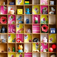 """Display treasured possessions: An old type case lined with wallpaper is a great way to display collected treasures in a little girl's room or playroom."""