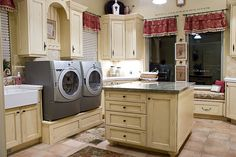 If I have to do laundry, at least the space is worthy of a little multi-tasking possibilities....hate the colors, love the design