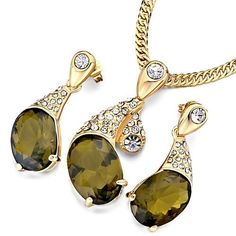 Pugster Gold Petal Clear Crystal Olivine Rhinestone Oval Pendant Earrings Set Pugster. $24.49. Perfect gift for Christmas. Free Jewerly Box. Designed from Swarovski Element Cystal. Money-back Satisfaction Guarantee. Free Chain in a matching metal will be included
