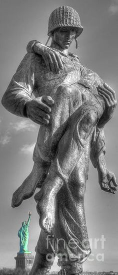 Freedom is Never Free. Liberation is a bronze Holocaust memorial created by the sculptor Nathan Rapoport, located in Liberty State Park in Jersey City.  Officially dedicated on May 30, 1985. It portrays an American Soldier carrying the body of a Holocaust survivor out of a Nazi concentration camp.
