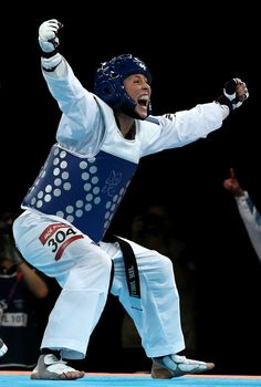 Great Britain's Jade Jones celebrates winning gold against China's Yuzhuo Hou in the womens -57kg gold medal Taekwondo final - Unbridled joy.