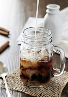 You'll love the creamy, rich flavor of this Honey Cinnamon Iced Coffee. Made with a capsule of your favorite Nespresso Grand Cru, you simply combine the coffee with milk, cinnamon, and a drizzle of homemade honey cinnamon simple syrup. Pour it over ice and enjoy all summer long!