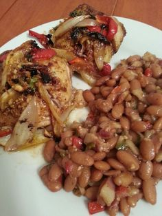 Peruvian roasted chicken and drunken peruano beans. The flavor on both can only be described as orgasmic
