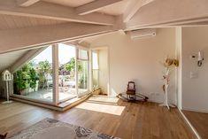 Mansarda open space: in stile di Bartolucci Architetti