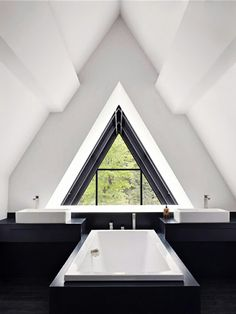 Pyramid power | Home Decor | Interior Design Inspiration | Bathroom | Black and White | Triangle Window |