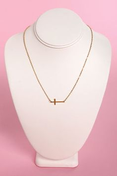 Check it out from Lulus.com! Are you lost without your Crossed and Found Gold Cross Necklace? Don't worry, because we found this dainty darling just for you! A thin gold chain dangles a sweet sideways cross charm for an easy everyday fix. Each cross measures 3/4