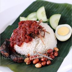 Nasi lemak is Malaysian coconut milk rice, served with sambal, fried crispy anchovies, toasted peanuts,and cucumber. Best nasi lemak recipe online!