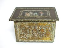 #Antique #English #Victorian brass #coal #scuttle box with social scenes. Soft textured brass with lion head pulls on each side.