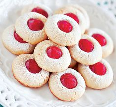 These Jam Thumbprint Cookies are the BEST! A delicious sugar cookie dough filled with your favorite jam, and then dusted with powdered sugar. These have become our all-time favorite cookie recipe for the Holidays! Powdered Sugar Cookies, Sugar Cookie Dough, Sugar Cookies Recipe, Yummy Cookies, Best Holiday Cookies, Holiday Cookie Recipes, Christmas Cookies, Christmas Meals, Holiday Baking