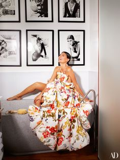 Battaglia-Engelbert—sitting pretty in a Rosie Assoulin dress—poses in the master bath, where portraits of her from an Eddie Borgo Campaign grid a wall.
