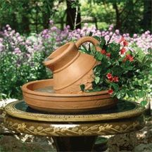Little Giant Classical Fountains come complete with tubing and pump!    Pictures is our classic pitcher in a Terracotta finish: http://www.lg-outdoor.com/p/ft-cp-t?pp=12
