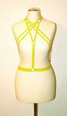 Electric yellow pleated harness with rings https://kivaleatheraccessories.wordpress.com/2015/01/20/cool-leather-harnesses-by-kiva/