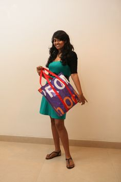 Dilini Rajapakse from Cinnamon Grand Colombo's Sales Department modelling a B2b (Banners to Bag) bag.