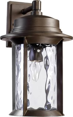 """The Charter Outdoor Wall Lantern by Quorum International adds a tasteful touch to any room. - Oiled Bronze Finish - Shade color: Clear Hammered - Designed with a Transitional theme - Dimensions: 15.5"""""""