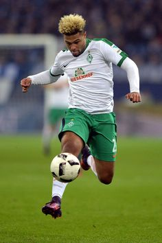 Serge Gnabry of Bremen runs with the ball during the Bundesliga match between FC Schalke 04 and Werder Bremen at Veltins-Arena on November 6, 2016 in Gelsenkirchen, Germany.