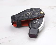 StoryLeather.com - Ready to Ship Coaster Genuine Leather Key Cover in Blue Pebble... Leather Key Holder, Leather Key Case, Leather Cover, Leather Wallet, Mercedes Accessories, Paper Bag Design, Mercedes Benz Maybach, Leather Coasters, Key Covers