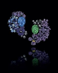 AN IMPRESSIVE PAIR OF MULTI-GEM 'BOUQUET OF FLOWERS' EAR PENDANTS, BY JAR. One centering upon a 58.50-carat oval-cut no heat sapphire from Sri Lanka, the other one centering upon a 42.85-carat oval-cut tsavorite garnet, each within a floral surround set with colored sapphires, amethysts, green garnets, black spinels and diamonds, 2013, mounted in blackened gold, silver and aluminum. Signed, box. Price realised USD 1,212,500 // Estimate USD 1,000,000 - USD 1,500,000 [C. NY - 6 DEC. 2017]