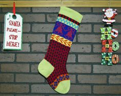 Hang this charming, hand knit stocking by the fireplace this Christmas. I knit the cuff, heel and toe in a Pale Green color called Soft Fern. This stocking also features bells in Rich Orchid Pink and a fun brick pattern on the leg in dark Purple and cherry Red. Simply fill with Christmas goodies and bring a custom touch to your Christmas decor.  The appearance of colors may vary from screen to screen. Please read description carefully if you want a specific color. If you have questions…