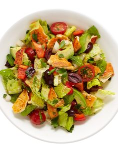 Get this easy-to-follow fattoush salad recipe made with romaine, a mix of bright veggies, crunchy pita bread pieces and a lemon vinaigrette.