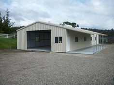 metal buildings with living quarters | light commercial steel building that protects side windows with an ...
