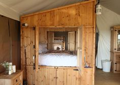 For Glampers that are nervous about wildlife at night...Close yourself in the queen size bed. The swinging doors on both sides enclose the entire bed.
