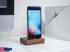 Solid walnut and cork docks for iPhone and Apple Watch.