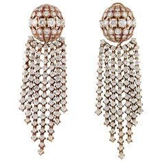 Van Cleef & Arpels Day and Night Diamond Gold Tassel Earrings | From a unique collection of vintage dangle earrings at https://www.1stdibs.com/jewelry/earrings/dangle-earrings/
