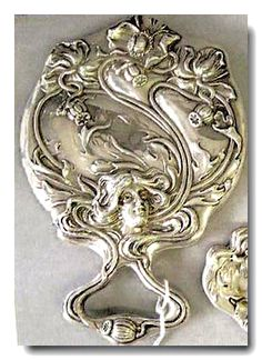 "William B. Kerr hand mirror in the ""American Beauty"" series of Art Nouveau repoussé;"