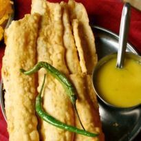 Fafda Recipe - Fafda is a popular Gujarati snack made with gram flour, turmeric and carom seeds. It is fried crisp and served with chutney. Gujarati Cuisine, Gujarati Recipes, Indian Food Recipes, Gujarati Food, Spicy Recipes, Fish Recipes, Vegetarian Recipes, Cooking Recipes, Breakfast Snacks