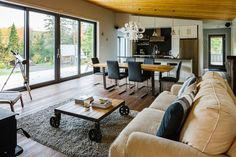I love the open feeling.  Great for entertaining. Chalet Bolton-Est by Boom Town | Living Room