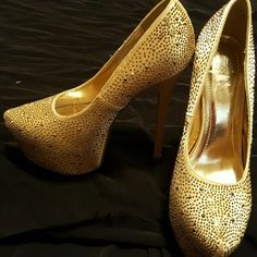 Gold Studded Stilettos This is a new pair of 6 inch heels with a 2.5 inch toe platform. They are gold with gold studs. Shoes have never been worn. Shoes are not in a box.  NWOT Shoes Heels