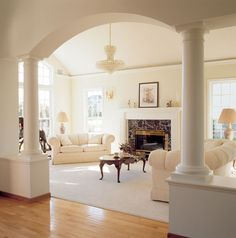 I love the columns and the large fireplace/mantle. Perhaps different colors though