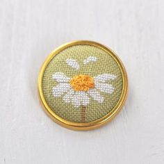 Daisy Brooch Pin // Hand Embroidered Floral by LivingOnTheRainbow 123 Stitch, Tiny Cross Stitch, Simple Cross Stitch, Cross Stitch Flowers, Cross Stitch Boards, Cross Stitch Designs, Cross Stitch Patterns, Embroidery Art, Cross Stitch Embroidery