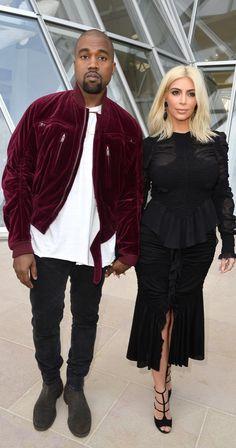 Kanye West wearing a cranberry velour jacket and Kim Kardashian in a black  peplum ensemble. 1456554b106