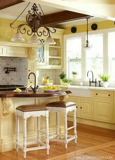 Love the white countertop, yellow cabinets and wood accents...and the black fixtures!