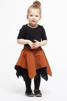 Eco Friendly Fashion for Boys and Girls | Long-sleeved bodysuit in soft jersey made from organic cotton with press-studs at the crotch and shoulder pads with buttons. One of the true classics and the base of a stylish wardrobe. Can also be worn with our removable cuff or puff sleeves. Explore our sustainable fashion for kids at  https://www.infantiumvictoria.com/collections/urgothic-collection/products/basic-bodysuit | Vegan Baby Clothes