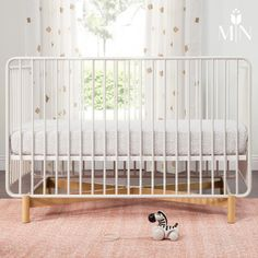 The Bixby 3-in-1 Convertible Crib is distinctly modern, yet warm and fresh with its rounded edges, powder-coated metal frame, and stained hardwood base.
